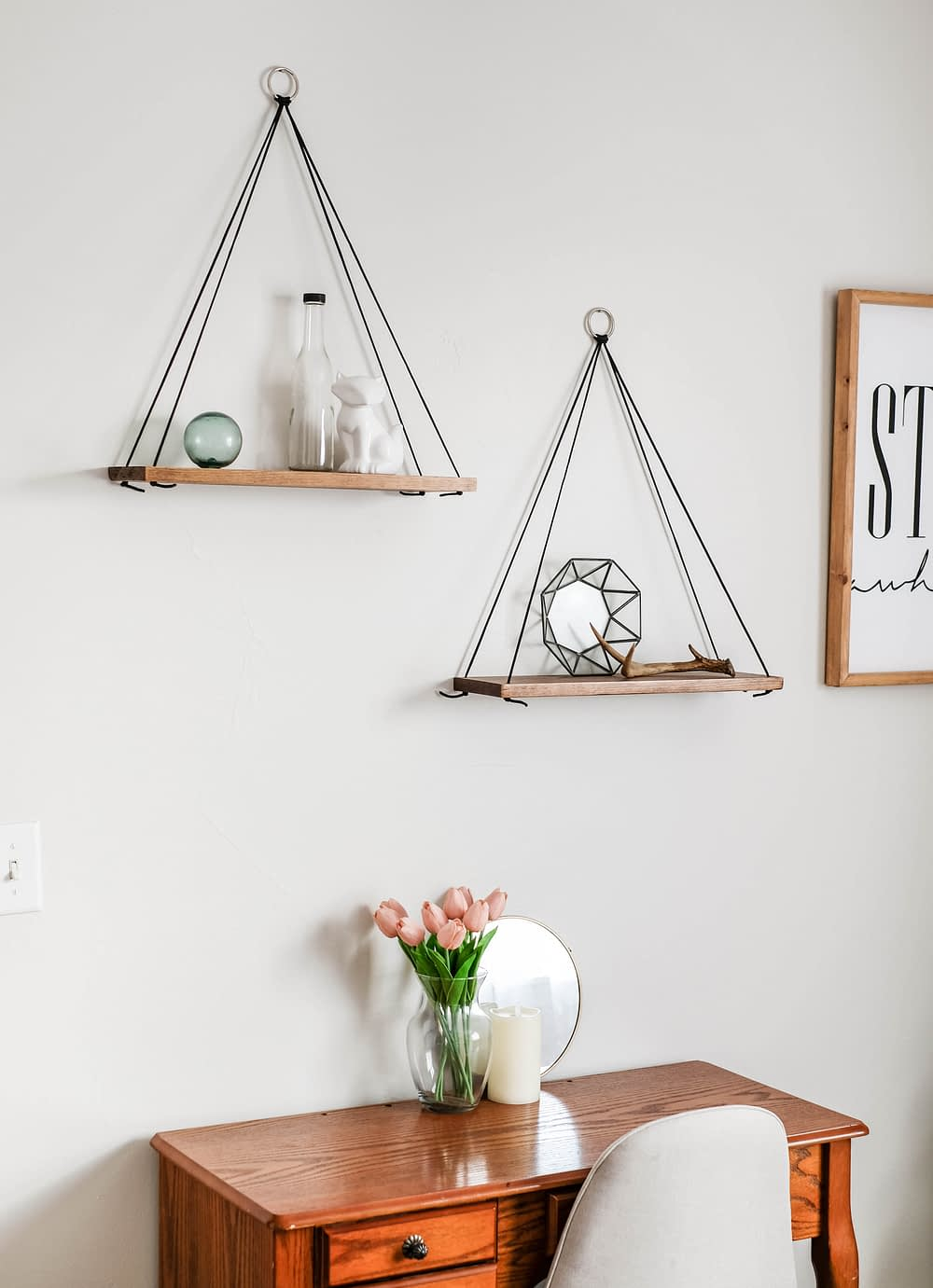 wall hanging shelfs with light bright decor on a white wall