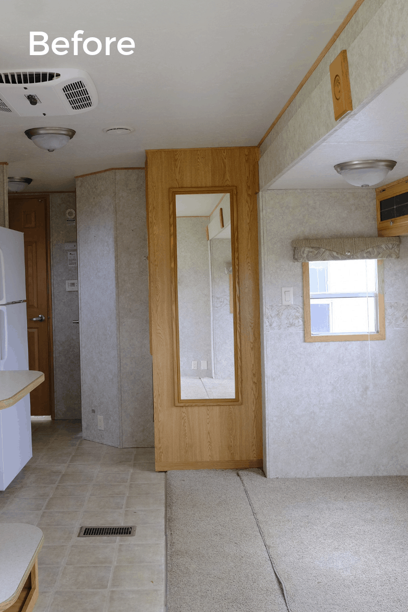 RV kitchen remodel before photo of original pantry with a long skinny mirror on the side