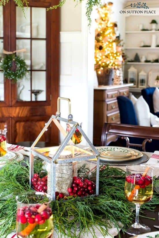 Christmas table centerpieces using a galvanized lantern, birch candles and cranberries