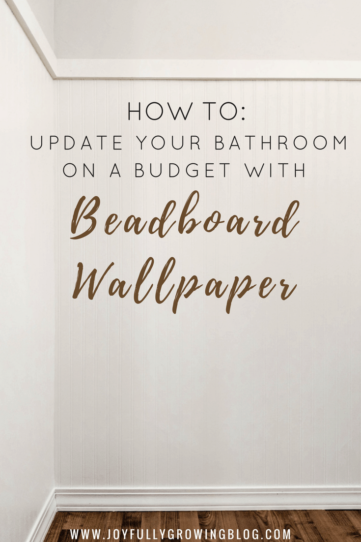 """White beadboard wall with trim and wood floors below. Text overlay says, """"How to: update your bathroom on a budget with beadboard wallpaper"""""""