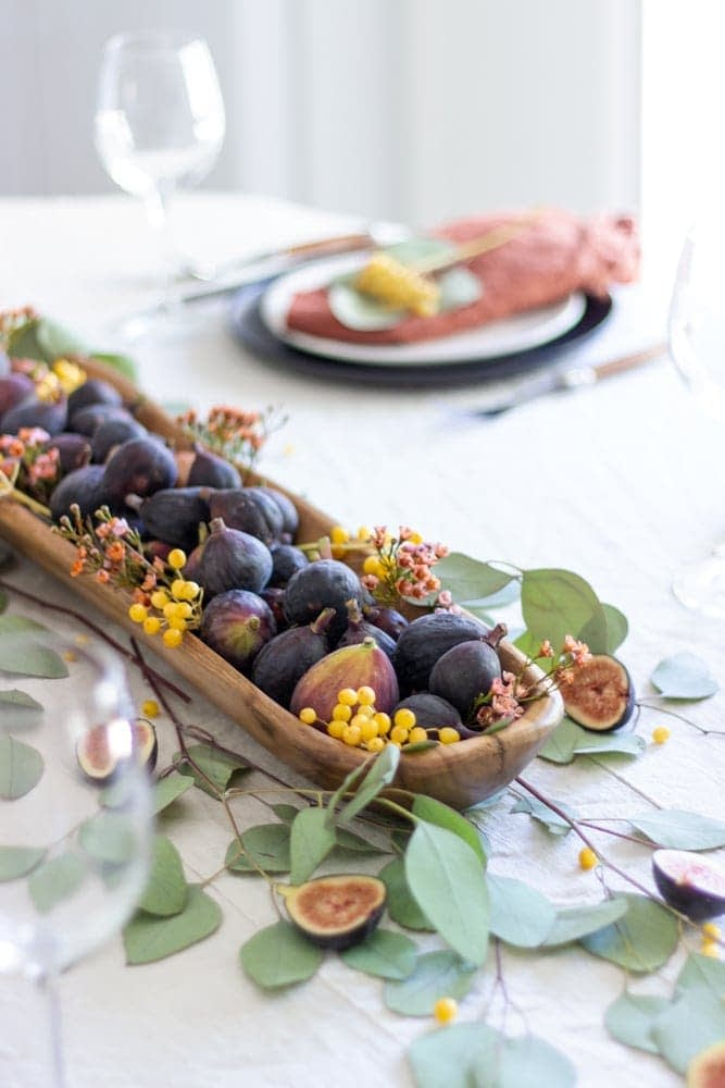 Thanksgiving table centerpieces with figs and a dough bowl
