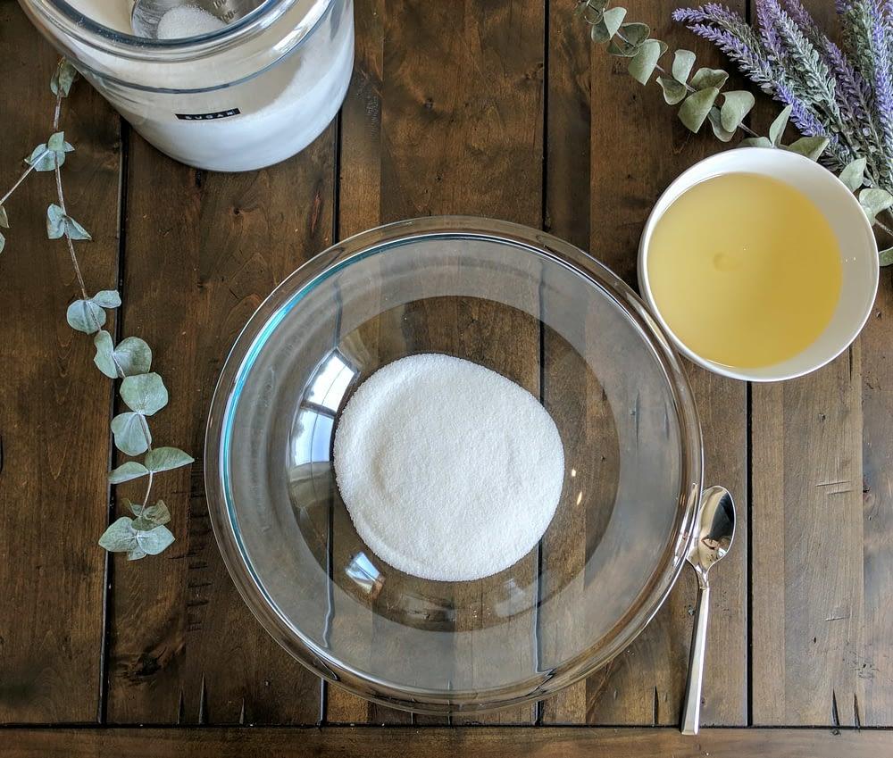 adding the sugar into DIY Sugar Scrub