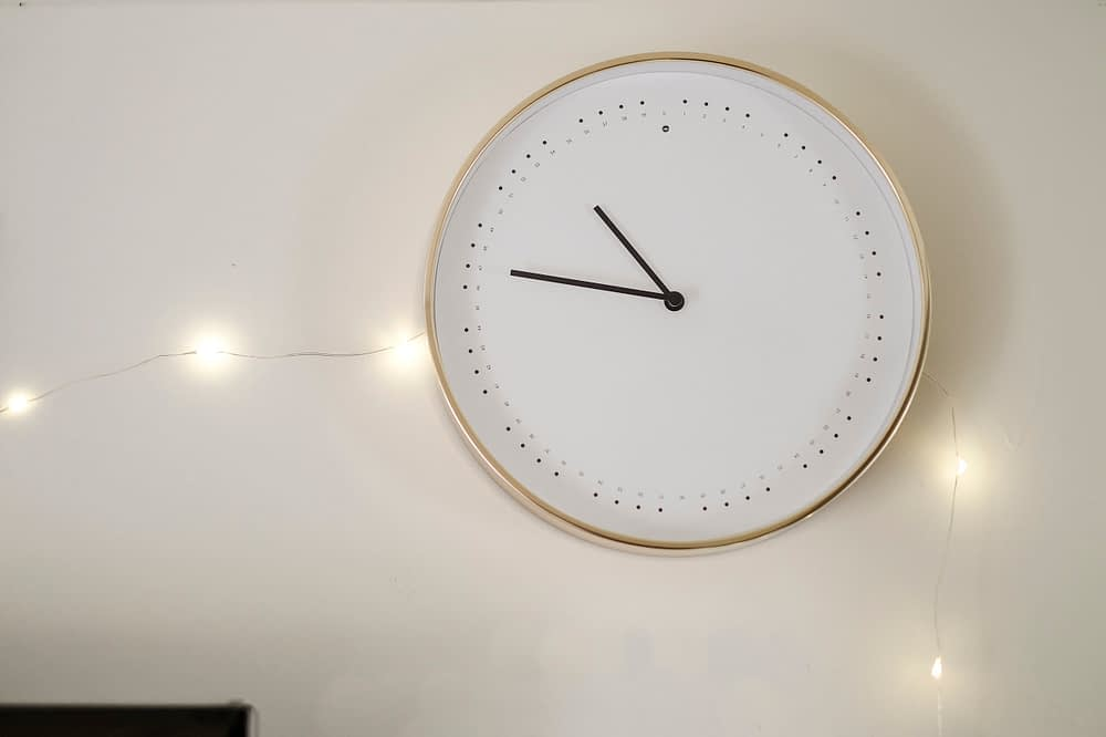 Wall clock with twinkle lights around it