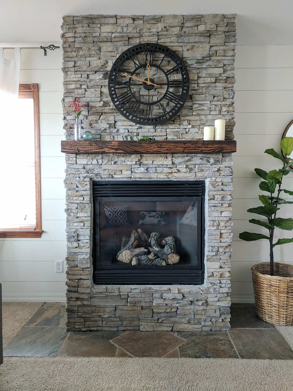 After the stacked stone fireplace renovation is completed with stone veneer