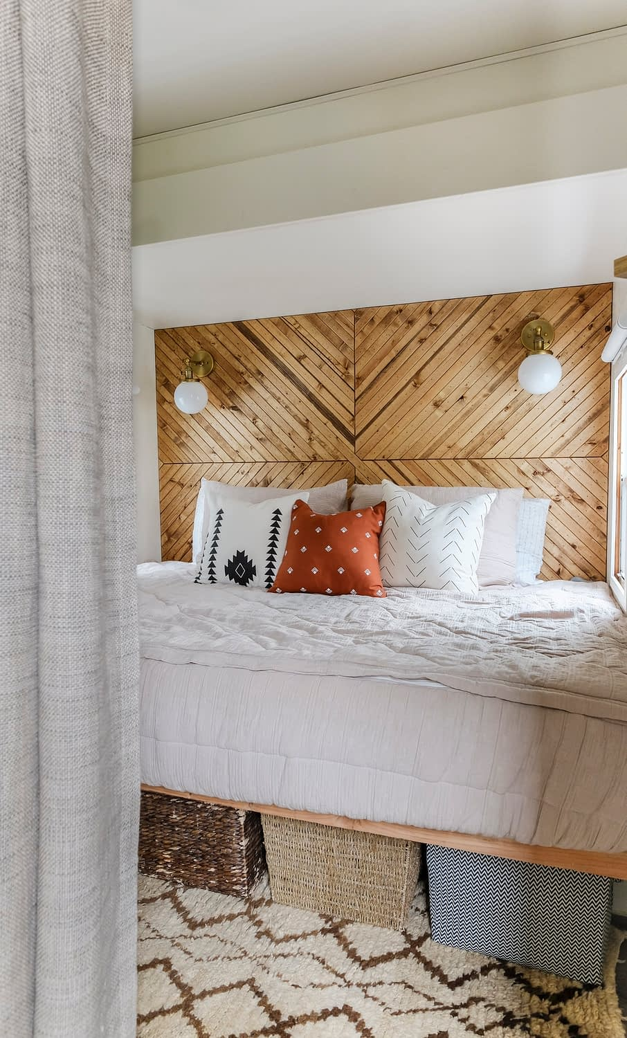RV bedroom remodel with a wood accent wall