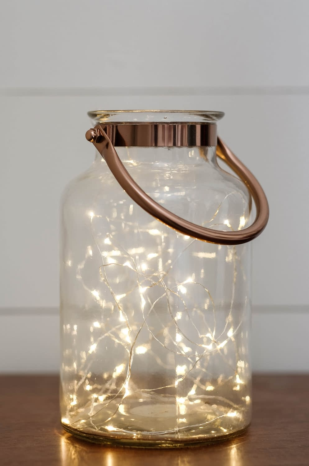 Christmas decor idea using a lantern filled with twinkle lights
