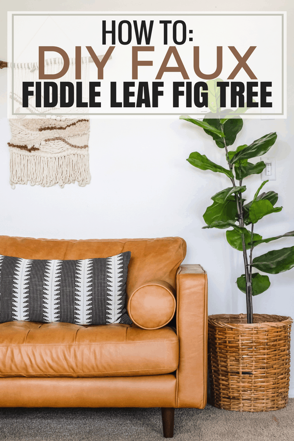 faux fiddle leaf tree standing next to leather couch