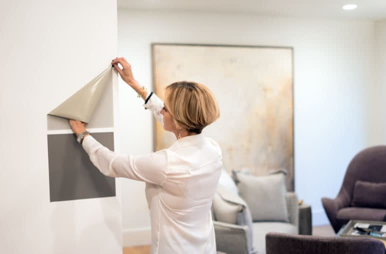 sticking a Samplize paint sample on a wall
