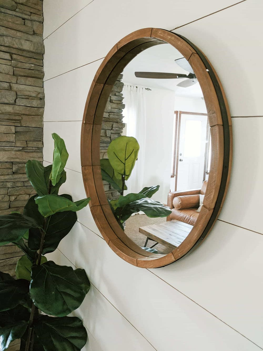 Mirror on a living room wall to brighten the room