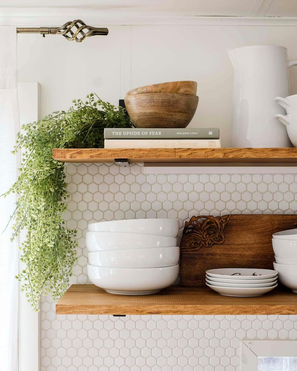 RV kitchen remodel with open shelving and hexagon tile backsplash