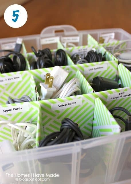 Cords and cables stored in an ornament organizer box with labels