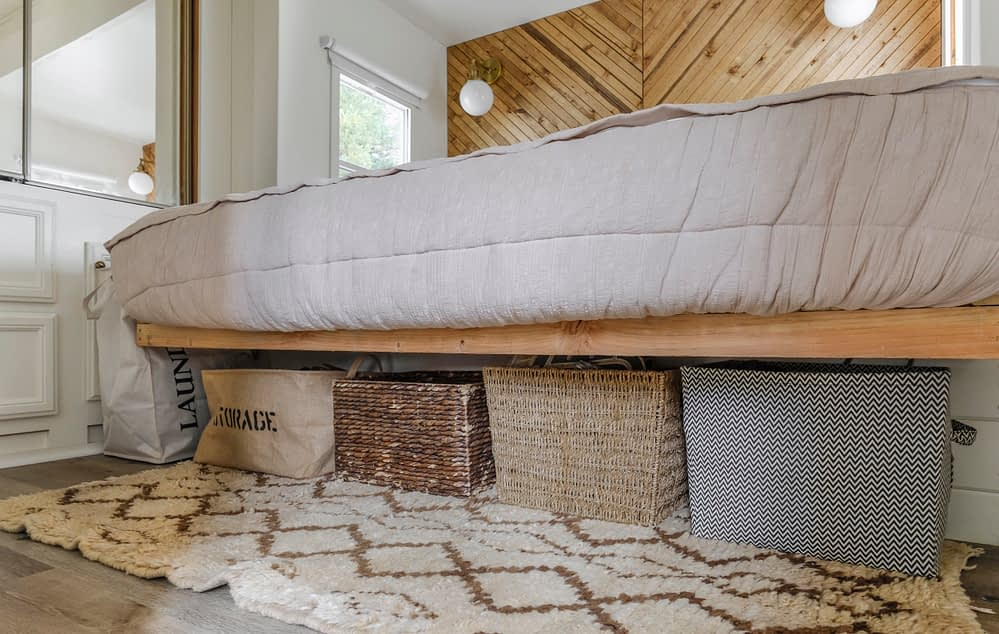 RV bed with baskets underneath for storage