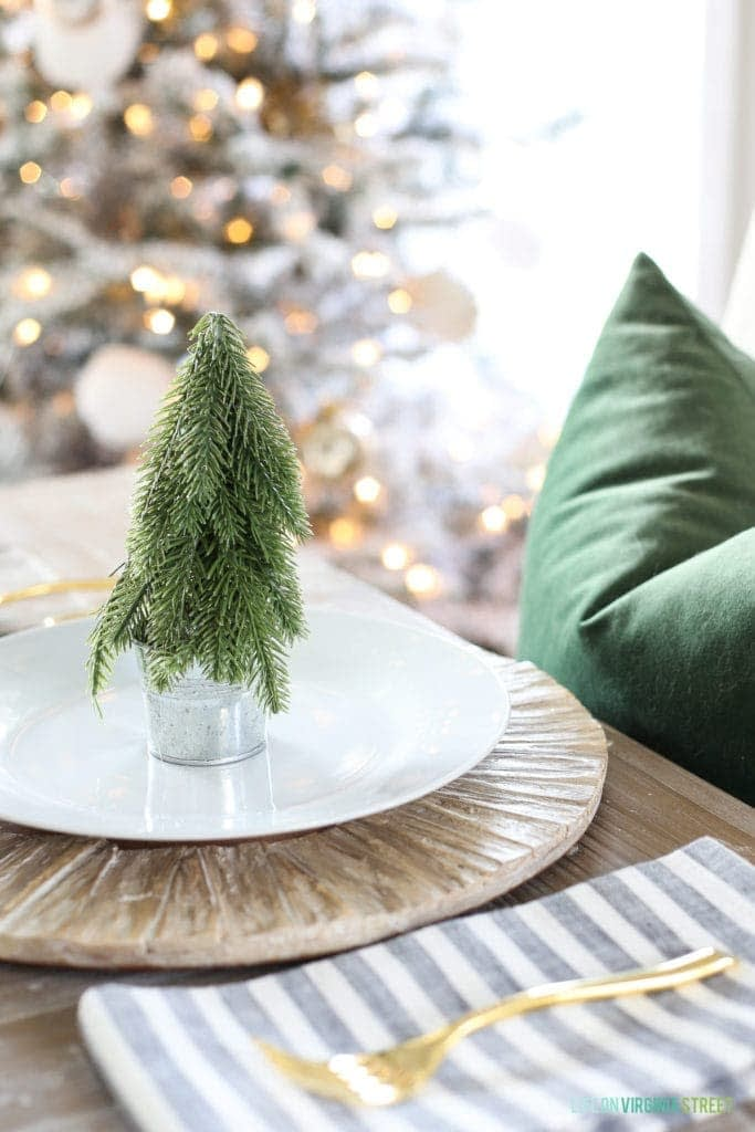 Mini artifiical tree in the center of a plate for a simple Christmas table setting ideas