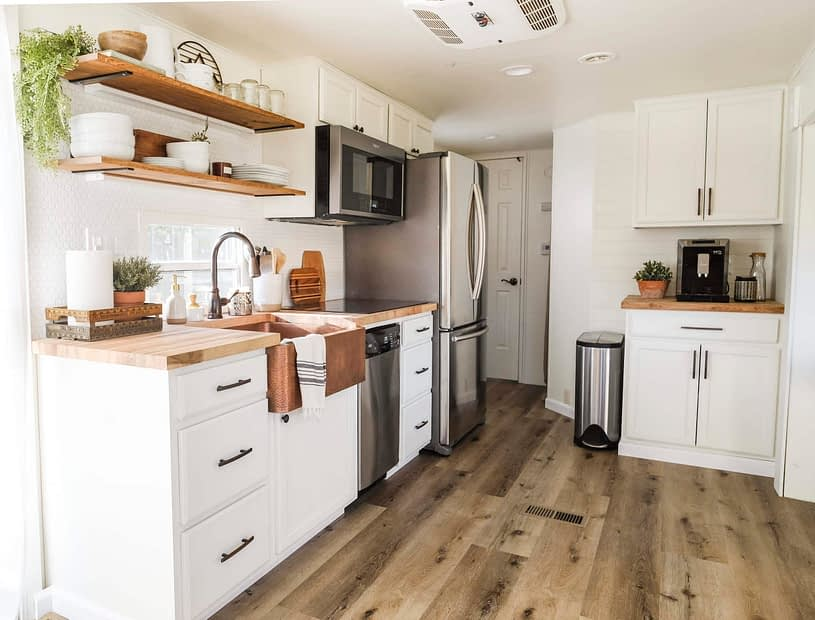RV kitchen remodel with white cabinets wood look flooring and open shelves