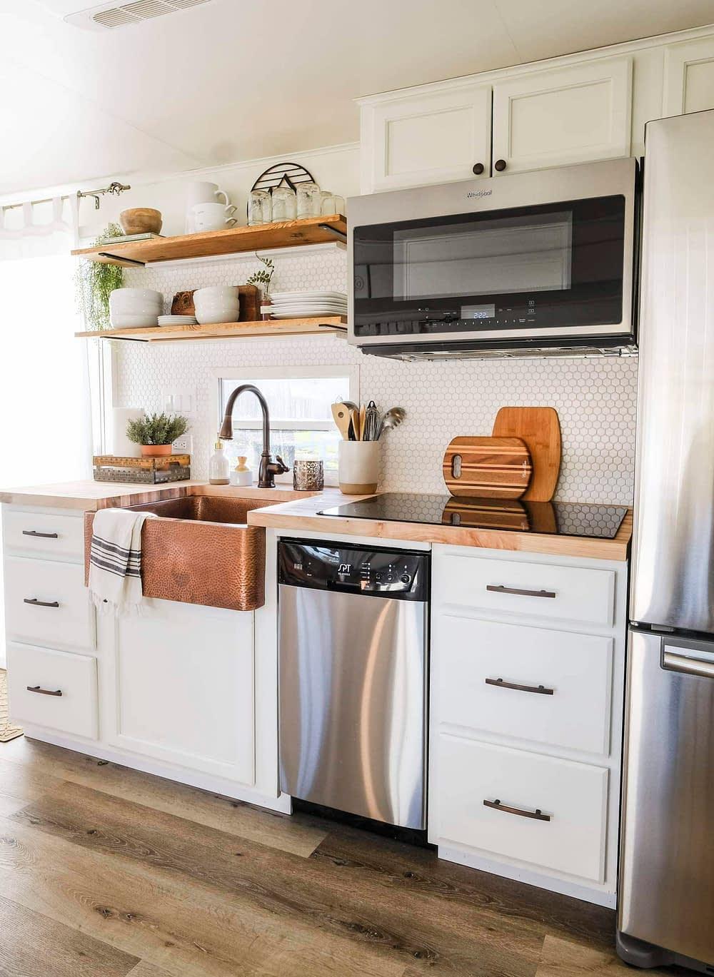RV kitchen remodel with white cabinets and wood look flooring