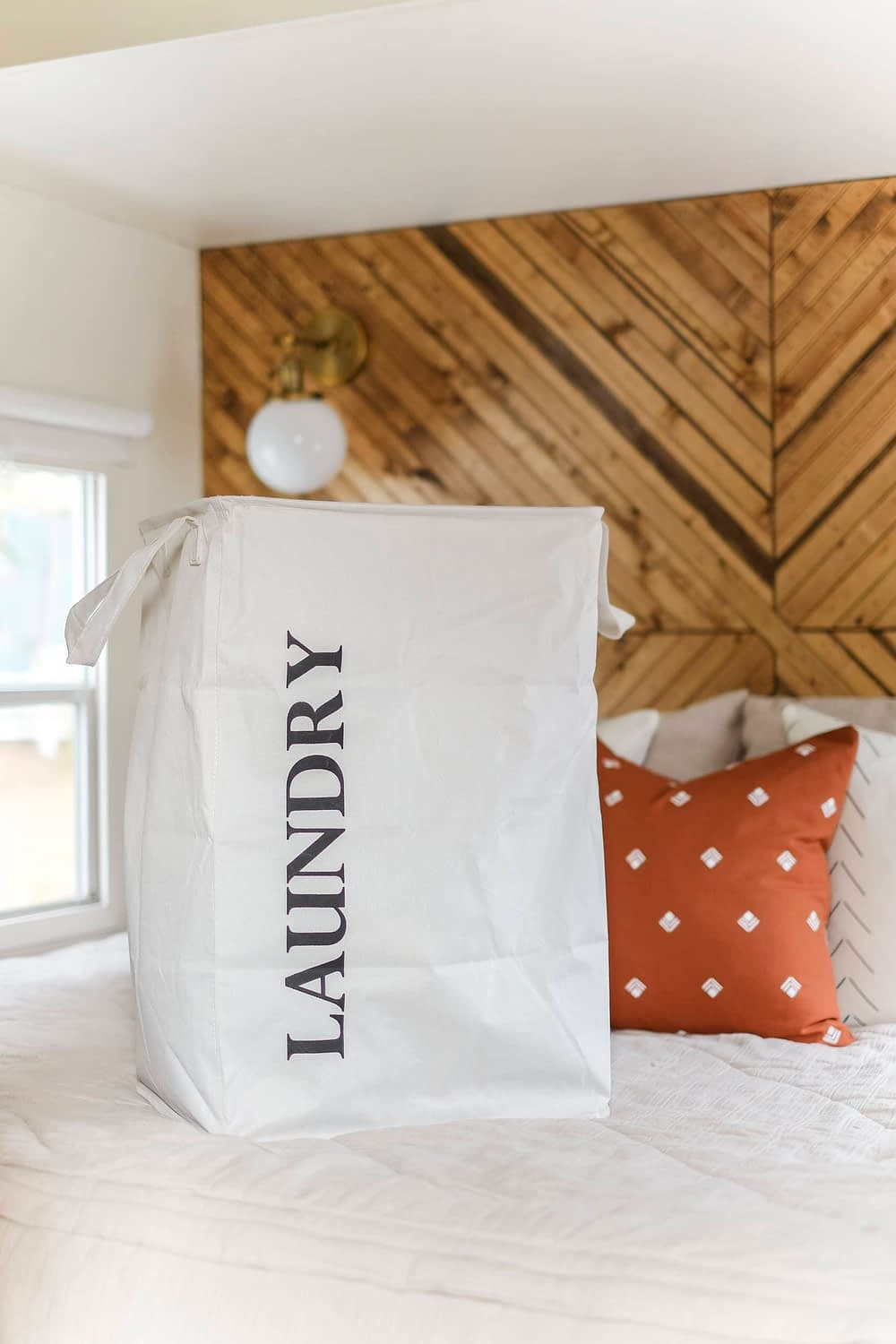 Laundty tote sitting on top of bed in an RV