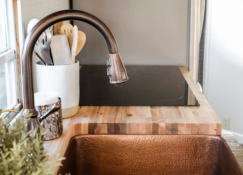 RV kitchen remodel with copper accents and butcher block countertops
