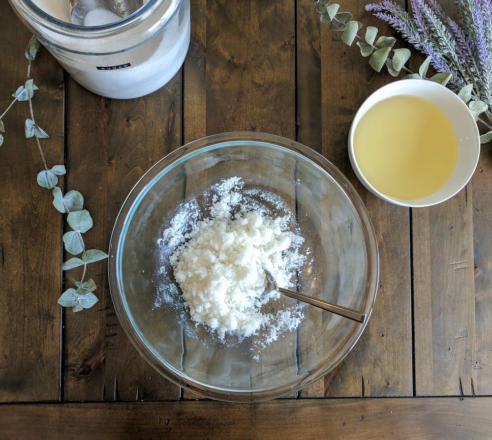 adding the coconut into DIY Sugar Scrub