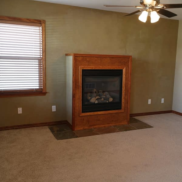 before image of a gas fireplace in an ugly wood box frame