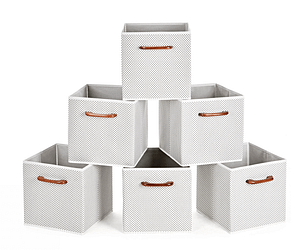 a set of five grey storage bins with leather handles