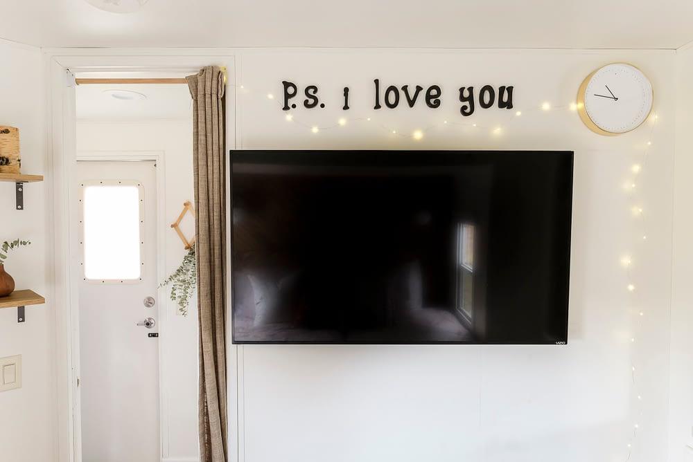 Wall mounted flat screen TV in an RV