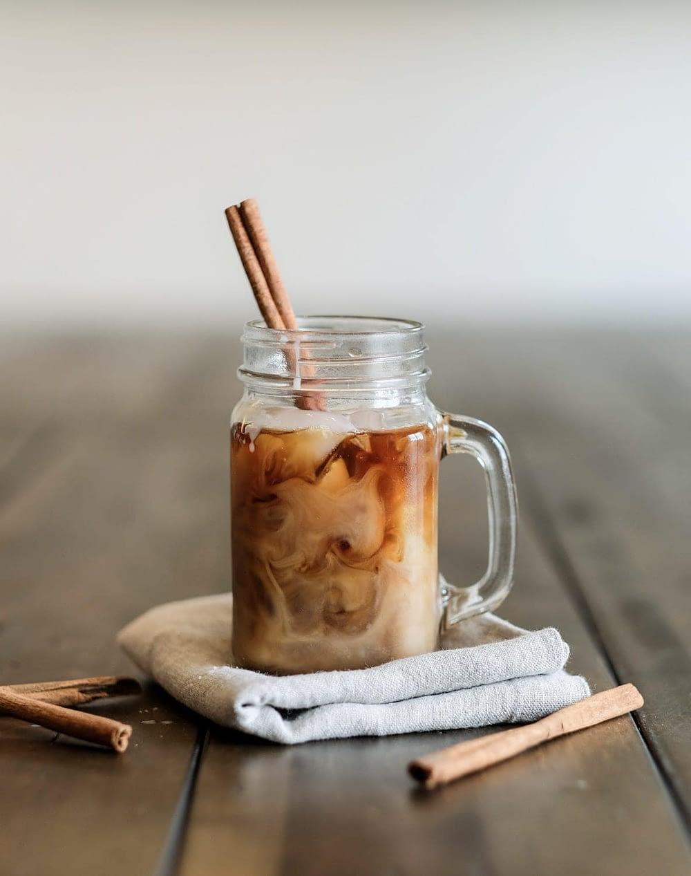 cold brew coffee in a mason jar with a cinnamon stick