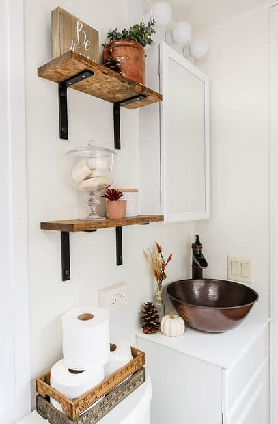 RV bathroom remodel with copper sink and open shelving