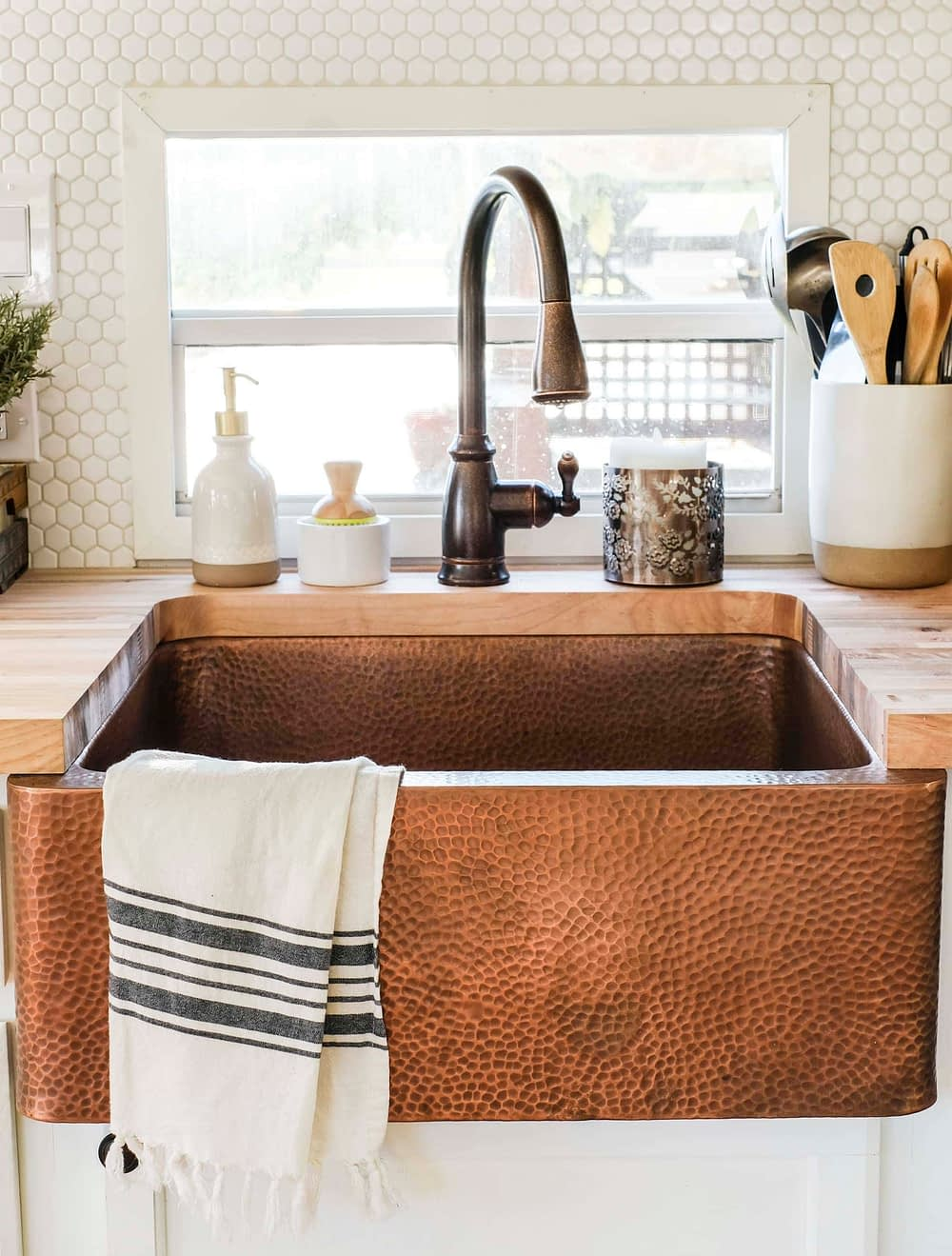 RV kitchen remodel featuring am apron front copper sink