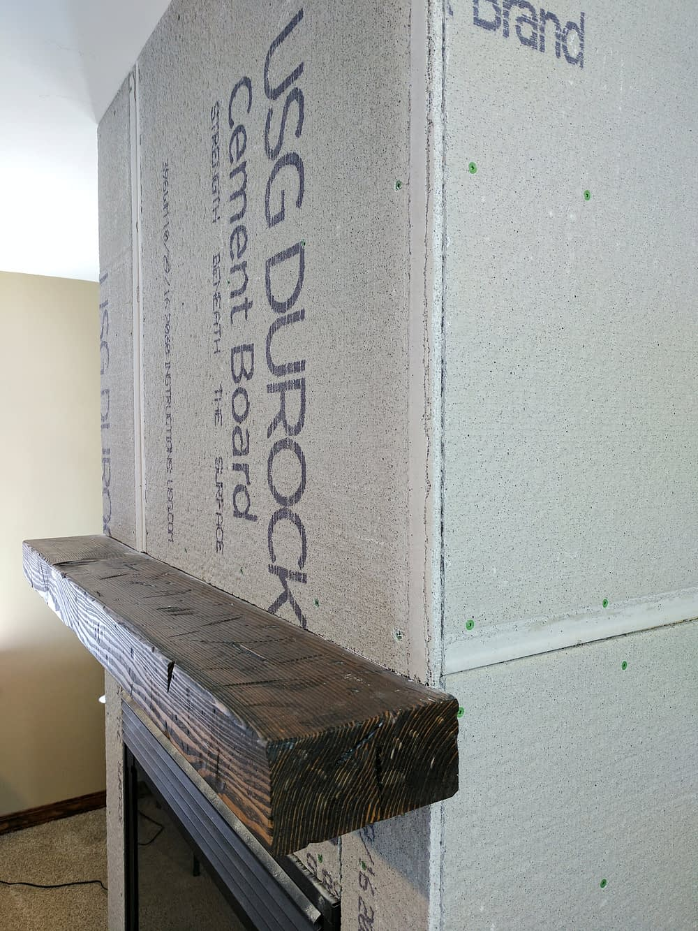 fireplace remodel with cement board installed over studs