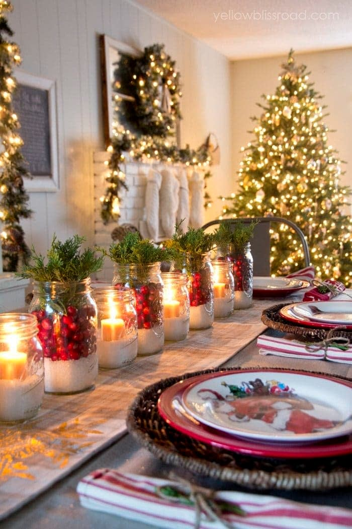 Christmas table centerpiece using mason jars, cranberries, and candles