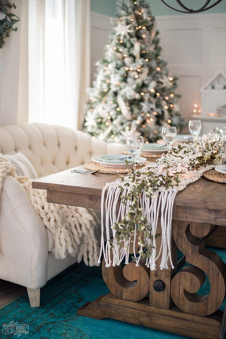 Christmas tablescape using a macrame table runner and a sofa as a bench seat