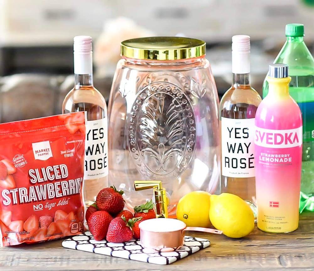 Ingredients for summer sangria recipe on countertop