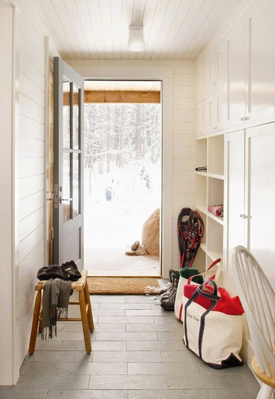 mud room with ship lap walls an ceiling painted white